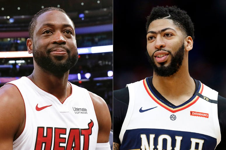 This combination of photos shows Miami Heat guard Dwyane Wade after an NBA basketball game against the New York Knicks in New York on March 30, 2019, left, and New Orleans Pelicans forward Anthony Davis during an NBA basketball game in New Orleans on Marc