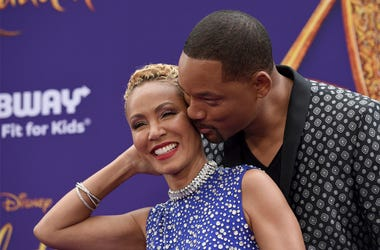 "In this May 21, 2019 file photo, Will Smith, right, kisses Jada Pinkett Smith as they arrive at the premiere of ""Aladdin"" at the El Capitan Theatre in Los Angeles. (Photo by Chris Pizzello/Invision/AP, File)"