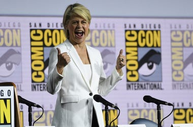 """Linda Hamilton reacts to the audience as she walks on stage at the """"Terminator: Dark Fate"""" panel on day one of Comic-Con International on Thursday, July 18, 2019, in San Diego. (Photo by Chris Pizzello/Invision/AP)"""