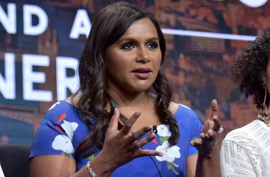 """Co-creator/executive producer Mindy Kaling speaks in Hulu's """"Four Weddings and a Funeral"""" panel at the Television Critics Association Summer Press Tour on Friday, July 26, 2019, in Beverly Hills, Calif. (Photo by Richard Shotwell/Invision/AP)"""