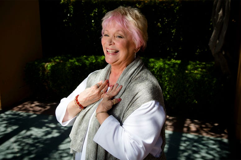 In this June 3, 2014 photo, Disney legend Russi Taylor stands amidst the long shadows at the Disney Legend Plaza at Disney Studios in Burbank, California. (Gina Ferazzi/Los Angeles Times via AP)