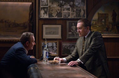 "This image released by Netflix shows Joe Pesci, left, and Robert De Niro in a scene from ""The Irishman."" The film will make its world premiere at opening night of the New York Film Festival on September 27. (Niko Tavernise/Netflix via AP)"