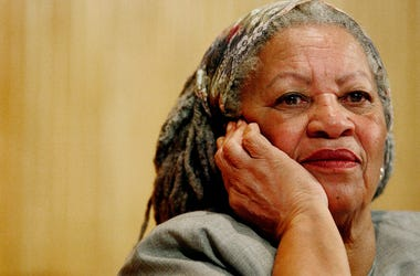 In this Nov. 25, 2005 file photo, author Toni Morrison listens to Mexicos Carlos Monsivais during the Julio Cortazar professorship conference at the Guadalajara's University in Guadalajara City, Mexico. (AP Photo/Guillermo Arias, File)
