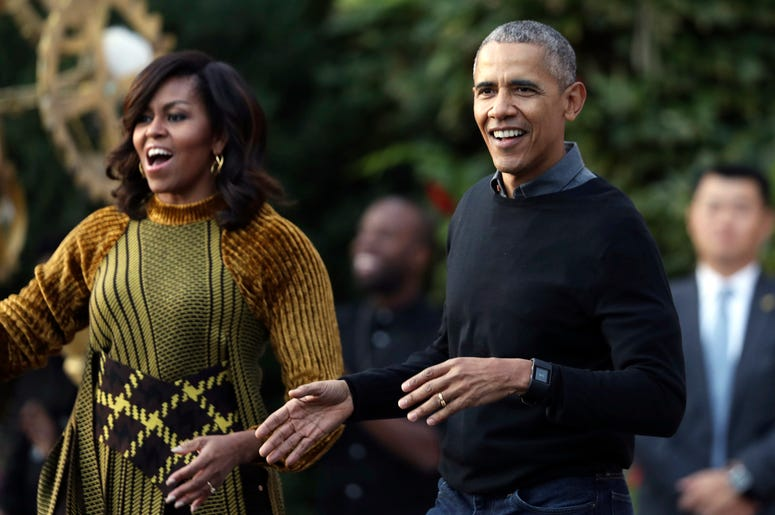 """In this Oct. 31, 2016 file photo, President Barack Obama and the first lady Michelle Obama dance with kids to the beat of """"Thriller"""" during a Halloween celebration at the South Portico of the White House in Washington. (AP Photo/Manuel Balce Ceneta, File)"""
