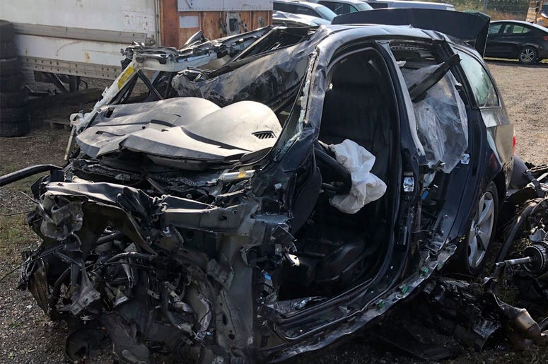 This Tuesday, Oct. 1, 2019 photo, released by the Ontario Provincial Police, shows the a smashed up vehicle involved in a fatal crash with transport truck near Shelburne, Ontario. (Ontario Provincial Police/The Canadian Press via AP)