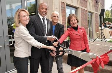 """University of Southern California Dean Erica Muhl, from left, Andre """"Dr. Dre"""" Young, Jimmy Iovine and USC President Carol Folt participate in the unveiling of a high-tech building named after Young and Iovine on the University of Southern California campu"""