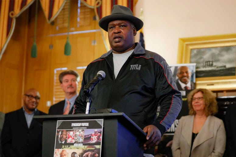 """James """"Buster"""" Douglas speaks during a news conference at the Ohio Statehouse to announce the """"42 to 1"""" initiative, Wednesday, Oct. 30, 2019, in Columbus, Ohio. Douglas is marking the 30th anniversary of his upset boxing victory over Mike Tyson with a cam"""