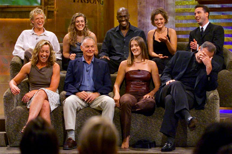 """In this Aug. 23, 2000, file photo, a group of """"Survivor"""" contestants, break into laughter during a live town hall meeting at CBS Studios in Hollywood in Los Angeles. Survivors are, from left, bottom row, Susan Hawk, Rudy Boesch, Kelly Wiglesworth and Rich"""
