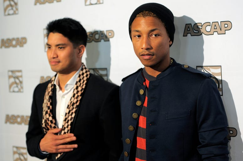 This June 29, 2012 file photo shows Pharrell Williams, right, alongside his producing partner Chad Hugo at the 25th Annual ASCAP Rhythm & Soul Music Awards in Beverly Hills, California. (Photo by Chris Pizzello/Invision/AP, File)