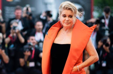 In this Aug. 28, 2019 file photo, French actress Catherine Deneuve poses for photographers upon arrival at the premiere of the film 'The Truth' and the opening gala at the 76th edition of the Venice Film Festival, Venice, Italy. (Photo by Arthur Mola/Invi