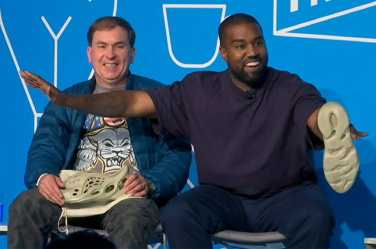This image taken from video shows Kanye West, right, with Steven Smith, lead designer at Yeezy during a discussion on fashion and design at the Fast Company Innovation Festival in New York on Thursday, Nov. 7, 2019. (AP Photo/David Martin)