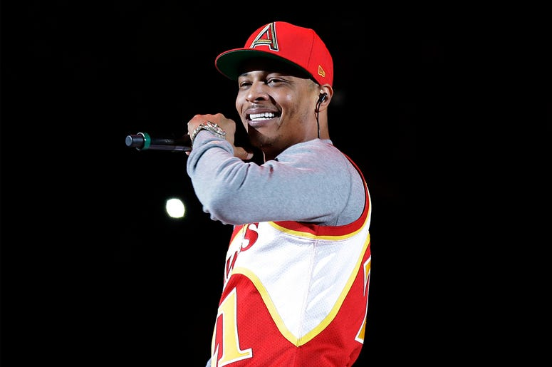 In this Nov. 1, 2014, file photo, rapper T.I. performs before the start of an NBA basketball game between the Indiana Pacers and the Atlanta Hawks in Atlanta. (AP Photo/David Goldman, File)