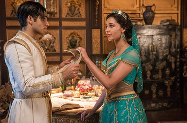 Mena Massoud as Aladdin and Naomi Scott as Princess Jasmine in Disney's 'Aladdin' (Photo credit: Disney)