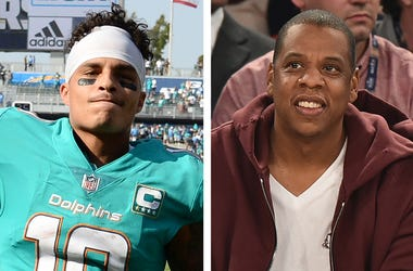 Miami Dolphins receiver Kenny Stills and rapper/music mogul Jay-Z (Photo credit: Kevork Djansezian/Theo Wargo/Getty Images)
