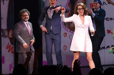 """Jeff Richmond, left, and Tina Fey participate in the curtain call for the """"Mean Girls"""""""