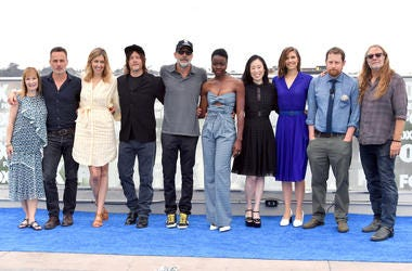SAN DIEGO, CA - JULY 20: (L-R) Gale Ann Hurd, Andrew Lincoln, Denise M. Huth, Norman Reedus, Jeffrey Dean Morgan, Danai Gurira, Angela Kang, Lauren Cohan, Scott M. Gimple and Greg Nicotero attend 'The Walking Dead' Photo Call during Comic-Con Internationa