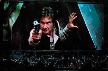Actor Harrison Ford's Han Solo character from 'Star Wars Episode VI: Return of the Jedi' is shown on screen while musicians perform during 'Star Wars: In Concert' at the Orleans Arena May 29, 2010 in Las Vegas, Nevada. The traveling production features a