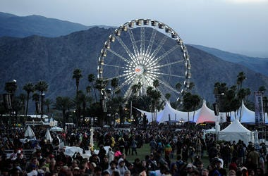 INDIO, CA - APRIL 13: The ferris wheel and the coachella music crowd during Day 1 of the 2012 Coachella Valley Music & Arts Festival held at the Empire Polo Club on April 13, 2012 in Indio, California. (Photo by Frazer Harrison/Getty Images for Coachella)