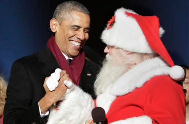 4 December 2014- Washington DC- U.S. President Barack Obama greets Santa Claus at the lighting of the National Christmas Tree. (Photo By Chris Kleponis/ISP/Sipa USA)