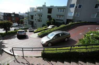SAN FRANCISCO, CA - MAY 20: Cars drive down Lombard Street on May 20, 2014 in San Francisco, California. The San Francisco Municipal Transportation Agency Board of Directors is considering a summer shutdown San Francisco's famed Lombard Street, known as t