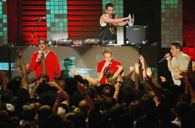 LAS VEGAS, NV - JUNE 9: (L-R) Michael Diamond 'Mike D', Adam Yauch 'MCA', Adam Horovitz 'Ad-Rock' and DJ Mix Master Mike(behind) of the Beastie Boys perform during MTV2's 2$Bill concert series at the Huntridge Theater, June 9, 2004 in Las Vegas, Nevada. (