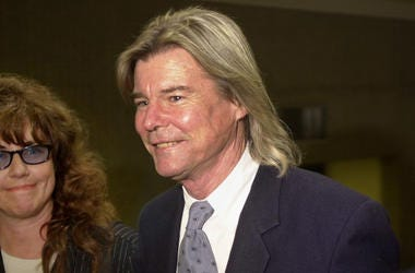 378867 01: Actor Jan Michael-Vincent arrives at court September 21, 2000 with his new wife of three months, and friend of 17 years, Anna, in Laguna Niguel, CA for arraignment on charges of probation violation after a public drunkeness arrest. Michael-Vinc