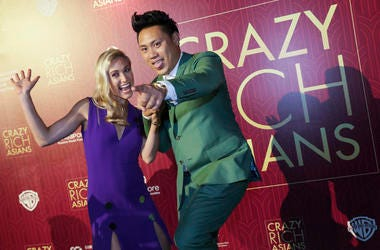 "Director John Chu and his wife Kristin Hodge pose for photographers as they arrive for the red carpet screening of the movie ""Crazy Rich Asians"" on Tuesday, Aug. 21, 2018, in Singapore. (AP Photo/Don Wong)"