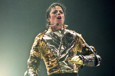 AUCKLAND, NEW ZEALAND - NOVEMBER 10: Michael Jackson performs on stage during is 'HIStory' world tour concert at Ericsson Stadium November 10, 1996 in Auckland, New Zealand. (Photo by Phil Walter/Getty Images)