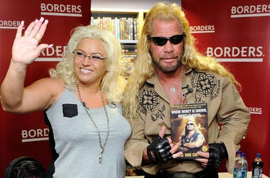 "NEW YORK - MARCH 19: Media personality Duane Chapman (right), known in the media as ""Dog the Bounty Hunter"" is joined by his wife Beth Chapman as he promotes his book ""When Mercy Is Shown, Mercy Is Given"" at Borders Wall Street on March 19, 2010 in New Yo"