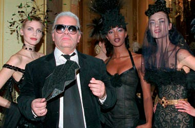 Karl Lagerfeld is surrounded by Canadian model Linda Evangelista, left, and British model Naomi Campbell, right, and other models after the presentation of his 1996-97 fall-winter haute couture fashion collection for Chanel in Paris.