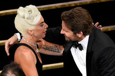 "Bradley Cooper, right, congratulates Lady Gaga in the audience after she is announced winner for best original song for ""Shallow"" from ""A Star Is Born"""