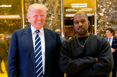 """In this Dec. 13, 2016, file photo, then-President-elect Donald Trump and Kanye West pose for a picture in the lobby of Trump Tower in New York. Trump is tweeting his thanks to rap superstar Kanye West for his recent online support. Trump wrote, """"Thank you"""