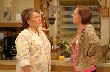 """In this image released by ABC, Roseanne Barr, left, and Laurie Metcalf appear in a scene from the reboot of the popular comedy series """"Roseanne."""" ABC, which canceled its """"Roseanne"""" revival over its star's racist tweet, said Thursday, June 21, 2018, it wil"""