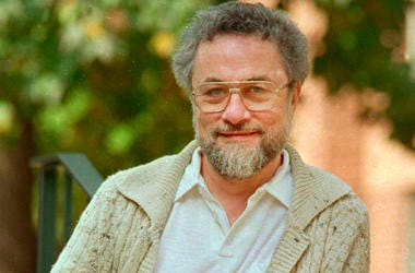 "In this October 1987, file photo, Adrian Cronauer, a disc jockey on the Saigon-based Dawn Buster radio show from 1965-1966 whose experiences in the Vietnam War were chronicled in the movie ""Good Morning, Vietnam,"" poses outside his home in Philadelphia, P"