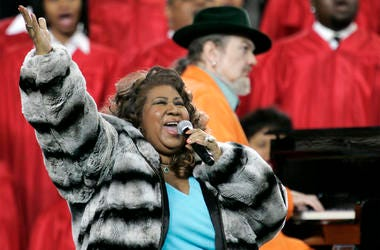 In this Feb. 5, 2006 file photo, Aretha Franklin and Dr. John, background on piano, perform the national anthem before the Super Bowl XL football game in Detroit. Franklin died Thursday, Aug. 16, 2018 at her home in Detroit. She was 76. (AP Photo/Gene J.