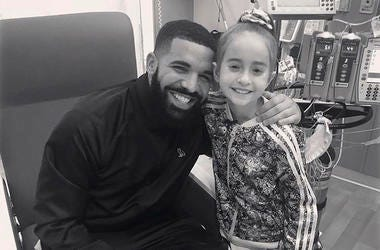 """This Monday, Aug, 20, 2018 photo provided by the rapper Drake shows him posing with Sofia Sanchez, at Lurie Children's Hospital in Chicago. Drake surprised her after she recorded a video of herself dancing to the rapper's """"In My Feelings"""" and invited him"""