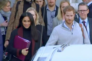 In this image made from video, Britain's Prince Harry, center right, and his wife Meghan Markle, left, Duke and Duchess of Sussex, approach a car at an airport in Sydney, Monday, Oct. 15, 2018. Prince Harry and his wife Meghan arrived in Sydney on Monday,