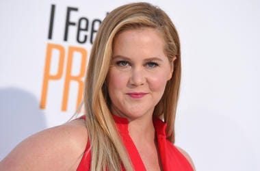 "In this April 17, 2018 file photo, Amy Schumer arrives at the world premiere of ""I Feel Pretty"" at the Westwood Village Theater in Los Angeles. Schumer says don't look for her in a Super Bowl commercial this time around. She's sitting this one out in supp"