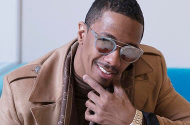 """In this Dec. 10, 2018 photo, Nick Cannon poses for a portrait in New York to promote promoting his new show, """"The Masked Singer."""" (Photo by Amy Sussman/Invision/AP)"""
