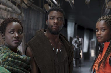 """This file image released by Disney shows Lupita Nyong'o, from left, Chadwick Boseman and Letitia Wright in a scene from """"Black Panther."""" The producers behind hits """"Black Panther,"""" """"Crazy Rich Asians,"""" """"A Star Is Born"""" and """"Bohemian Rhapsody"""" are among the"""
