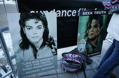 "Signs in support of Michael Jackson are seen outside of the premiere of the ""Leaving Neverland"" Michael Jackson documentary film at the Egyptian Theatre on Main Street during the 2019 Sundance Film Festival, Friday, Jan. 25, 2019, in Park City, Utah. (Pho"