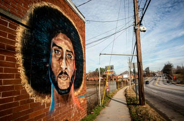 A mural depicting embattled NFL quarterback Colin Kaepernick is seen on a wall on Monday, Feb. 4, 2019, in Atlanta. Several such murals were hastily painted over the weekend across the Super Bowl host town in protest after one that had stood for two years