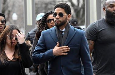 'Empire' actor Jussie Smollett, center, arrives at the Leighton Criminal Court Building for his hearing on Thursday, March 14, 2019, in Chicago. (AP Photo/Matt Marton)