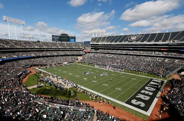 In this Oct. 28, 2018, file photo, fans watch during the first half of an NFL football game between the Oakland Raiders and the Indianapolis Colts at Oakland Alameda County Coliseum in Oakland, Calif.  (AP Photo/D. Ross Cameron, File)