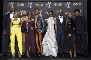 """The cast of """"Black Panther,"""" pose in the press room with the award for outstanding motion picture at the 50th annual NAACP Image Awards on Saturday, March 30, 2019, at the Dolby Theatre in Los Angeles. (Photo by Richard Shotwell/Invision/AP)"""