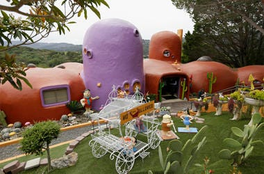 In this photo taken Monday, April 1, 2019, is an exterior view of the Flintstone House in Hillsborough, California. (AP Photo/Eric Risberg)