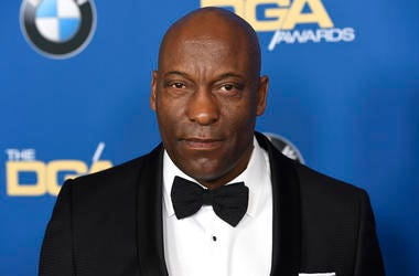 In this Feb. 3, 2018 file photo, John Singleton arrives at the 70th annual Directors Guild of America Awards in Beverly Hills, California. (Photo by Chris Pizzello/Invision/AP)