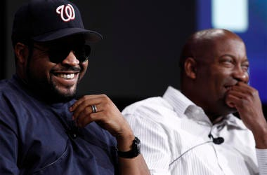 "In this July 29, 2008, file photo, Ice Cube, left, and director John Singleton, laugh during the ESPN panel for the documentary series ""30 for 30"" at the Television Critics Association summer press tour in Pasadena, California. (AP Photo/Matt Sayles, File"