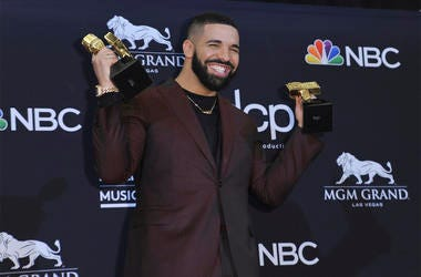Drake poses in the press room with his awards at the Billboard Music Awards on Wednesday, May 1, 2019, at the MGM Grand Garden Arena in Las Vegas. (Photo by Richard Shotwell/Invision/AP)