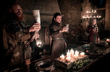 """This image released by HBO shows Kristofer Hivju, from left, Kit Harington and Emilia Clarke in a scene from """"Game of Thrones."""" (Helen Sloan/HBO via AP)"""